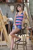 Young Brunette Sitting at Painters Easel Stock Image