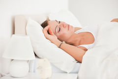 Young brunette sleeping in her bed Stock Photography