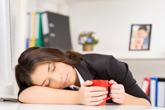 Young brunette sleeping at working time. Stock Photo