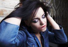 Young brunette with smeared lipstick on her face. Stock Image