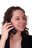Young Brunette Smiling and Talking on Phone Royalty Free Stock Image