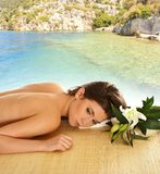 A young brunette on spa treatment procedure stock image