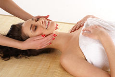 A young brunette on a spa treatment procedure Royalty Free Stock Photos