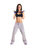 Young  woman  training with dumbbels Royalty Free Stock Photos