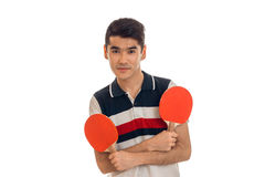 Young brunette sports man practicing ping-ping isolated on white background Royalty Free Stock Image