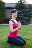 Young brunette sporty woman practicing yoga Stock Photo