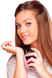 Young brunette spraying perfume Stock Images