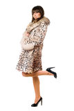 Young brunette standing on one leg Royalty Free Stock Images