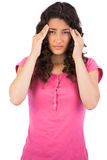 Young brunette suffering from headache Royalty Free Stock Image