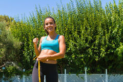 Young brunette sweating athlete in sportswear Stock Photo