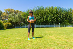 Young brunette sweating athlete in sportswear Royalty Free Stock Images