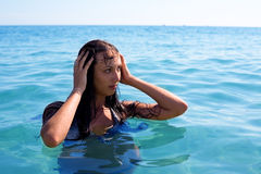 Young brunette swims in sea Stock Photos