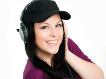 Young brunette teenager with headphones Royalty Free Stock Photography