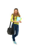 A young brunette teenager in school clothes Stock Images