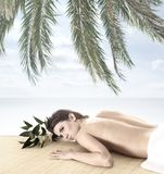 A young brunette on a tropical vacation Stock Photos