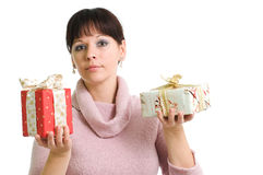 Young brunette with two Christmas presents. Isolated over white Stock Photos
