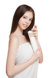 Young brunette using body lotion. Royalty Free Stock Photos