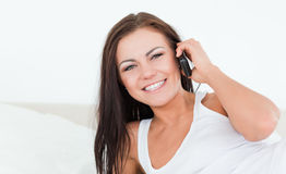 Young brunette using her phone Royalty Free Stock Photos