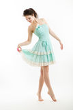 Young brunette in vintage style clothes is dancing. Stock Photo