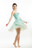 Young brunette in vintage style clothes is dancing. Stock Images