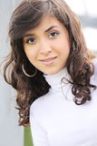 Young brunette in white Royalty Free Stock Images