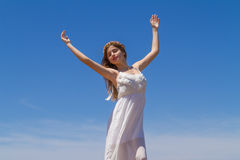 Young brunette in white flimsy dress enjoys the Stock Images