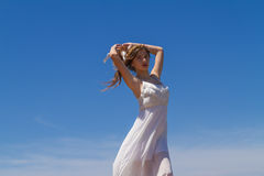 Young brunette in white flimsy dress Royalty Free Stock Photo