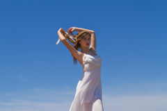 Young brunette in white flimsy dress Royalty Free Stock Images