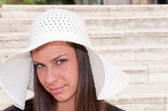 Young brunette with white hat Royalty Free Stock Photo