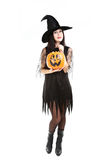 Young brunette witch Royalty Free Stock Image