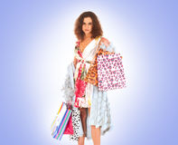 A young brunette witha a lot of shopping bags Stock Images