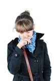 Young brunette woman. In black coat having a cold stock photography