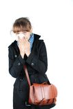 Young brunette woman. In black coat having a cold royalty free stock photography