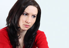 Young brunette woman. Close up of girl with long hair with serious expression Royalty Free Stock Photos