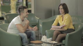 Young brunette woman with attractive man are relaxing in the hotel stock video footage