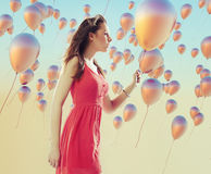 Young brunette woman among the balloons Stock Image