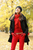 A young brunette woman in beautiful Autumn clothes Royalty Free Stock Photos