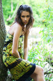 A young brunette woman in a beautiful green dress Stock Photography