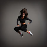 A young brunette woman in a beautiful jump Royalty Free Stock Image