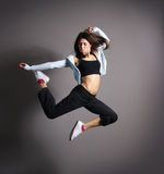 A young brunette woman in a beautiful jump Stock Images