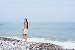 A young brunette woman on a beautiful shore Royalty Free Stock Images