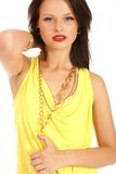 A young brunette woman in a beautiful yellow dress Royalty Free Stock Photography