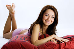 Young brunette woman on the bed Stock Image