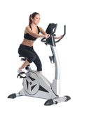 Young brunette woman on bike  exerciser Stock Image