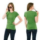 Young brunette woman with blank green shirt stock photography