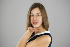 Young brunette woman blowing while sending an air kiss Royalty Free Stock Images