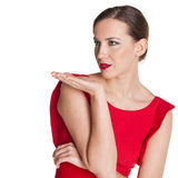 Young brunette woman blowing while sending an air kiss Royalty Free Stock Photo