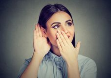 Surprised woman listening to gossips royalty free stock photo