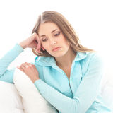 A young brunette woman in a blue sweater feeling sad Royalty Free Stock Image