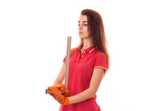 Young brunette woman builder in uniform makes renovations with tools in her hands looking away isolated on white Stock Photo